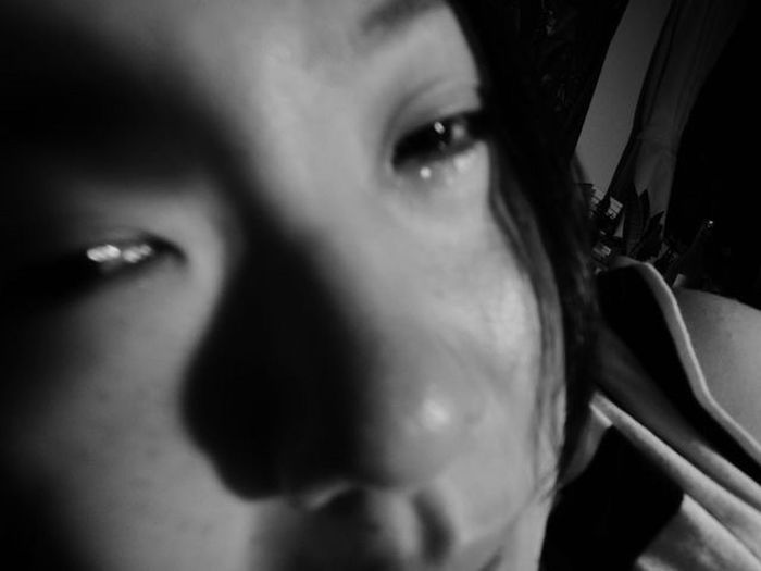 EyeEmNewHere Bonding Toghetherness Laying In Bed Monochrome Blackandwhite Midnightmemories Midnight Modelgirl Beautiful Girl W/Aya Portrait Crying One Person Young Adult Portrait Looking At Camera Human Eye Young Women Real People Indoors  Human Face Human Body Part People