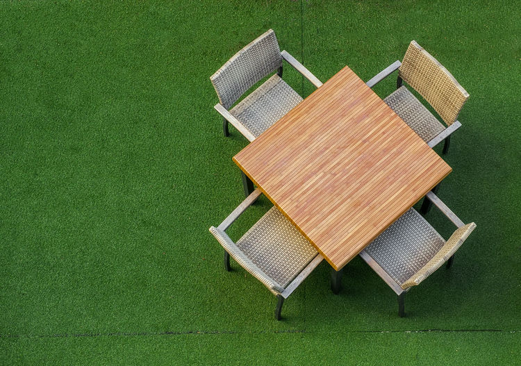 Empty table on green grass Empty Chair Four Chairs Chairs Day Directly Above Freshness Grass Green Color High Angle View No People Outdoor Outdoors Soccer Field Summer Table Decoration Table Top Top View Shot