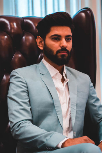 One Person Front View Business Indoors  Real People Men Males  Business Person Looking At Camera Businessman Young Adult Sitting Young Men Formalwear Well-dressed Beard Clothing Portrait Menswear Necktie Exploring Fun Springtime Decadence The Portraitist - 2019 EyeEm Awards