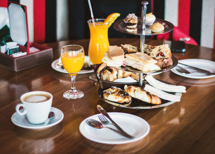 Full brunch served for two people. Food And Drink Drink Table Refreshment Glass Freshness Ready-to-eat Drinking Glass Plate Food Restaurant Indoors  Business No People Eating Utensil Meal Temptation Tasty Brunch Coffee Pastries Sweets Ham And Cheese Toasted Bread Orange Juice
