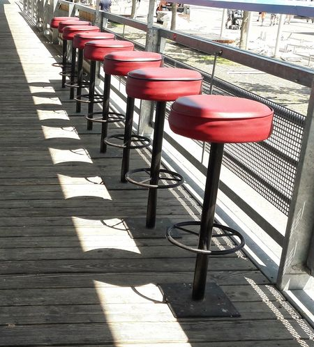 Take a seat Bar Stools Bar Stools In A Row Row Of Things Red Shadows Outdoors Chair Street Bar Street Restaurant Street Cafe Geometric Shapes Pattern, Texture, Shape And Form Wood - Material Empty No People Party Location Furniture Patterns