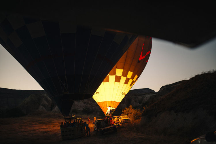 Transportation Hot Air Balloon Mode Of Transportation Air Vehicle Balloon Nature Travel Adventure Sky Incidental People Mountain Ballooning Festival Burning Outdoors Group Of People Parachute Fire Flying Environment Leisure Activity