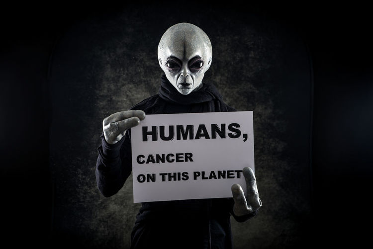 Portrait of alien with text against black background