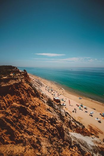EyeEm Selects Sea Beach Water Land Sky Sand Blue Day Tranquil Scene Beauty In Nature Horizon Over Water Vacations Trip Holiday Outdoors Nature Horizon Scenics - Nature Incidental People Tranquility EyeEmNewHere