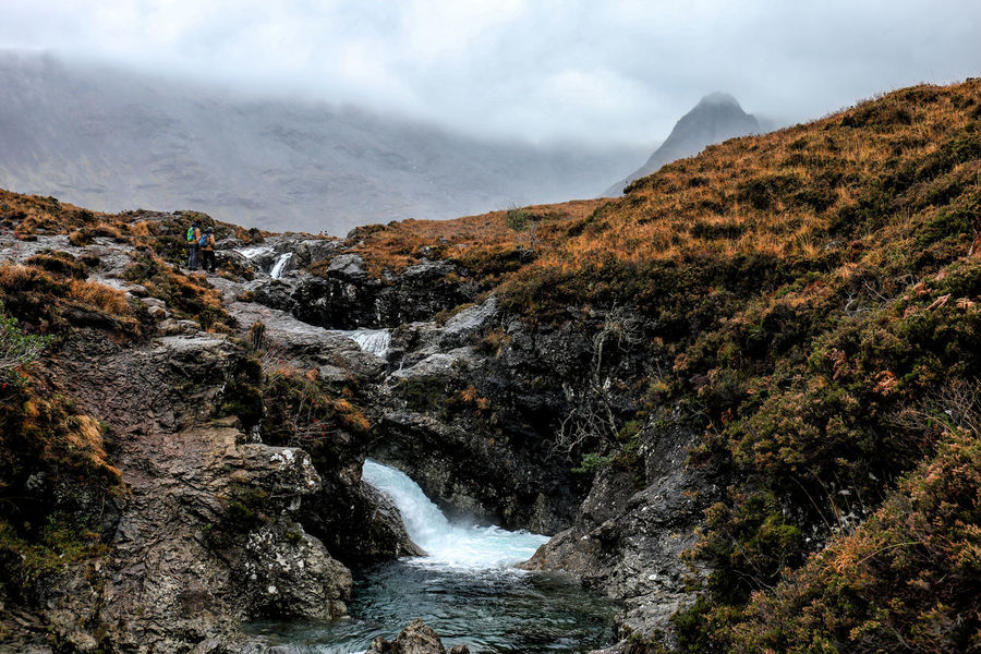 Last October I went to Scotland with my dad and one of my brothers; here we were at Fairy Pools, a magical place in the Isle of Skye, where the vivid blues and greens of the pools suggest an unnatural origin. Adventure Beauty In Nature Highlands Hiking Landscape Mountain Nature Outdoor Pursuit Outdoors Power In Nature Scotland Scotlandsbeauty Scott Travel Destinations Water Waterfall