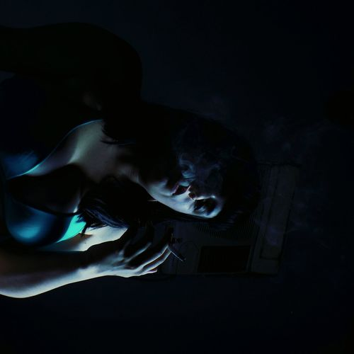 Young woman in darkroom