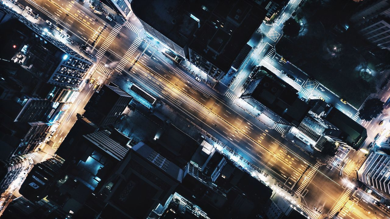Directly above shot of road amidst buildings in city at night