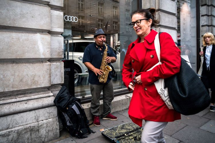 Lady in red street photography London street music Streetphotography Life On The Streets Uban Life Life In Motion Coloursplash red London Color Photography