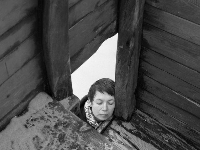 Portrait of boy on wooden floor