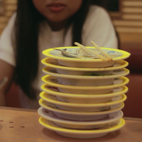 Close-up of stack of man on table