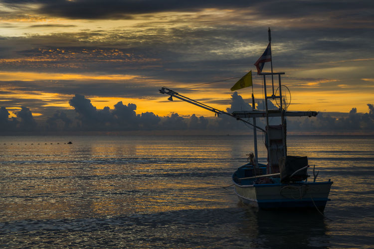 Fisherman's boat start working in dawn Beauty In Nature Cloud - Sky Fishing Boat Idyllic Mode Of Transportation Moored Nature Nautical Vessel No People Orange Color Outdoors Sailboat Scenics - Nature Sea Sky Sunset Tranquil Scene Tranquility Transportation Water Waterfront