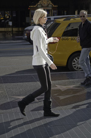 Candid Candid Photography Full Length Hollywood Blvd Leggings Listening To Music Observed Real People Side View Streetphotography Walking