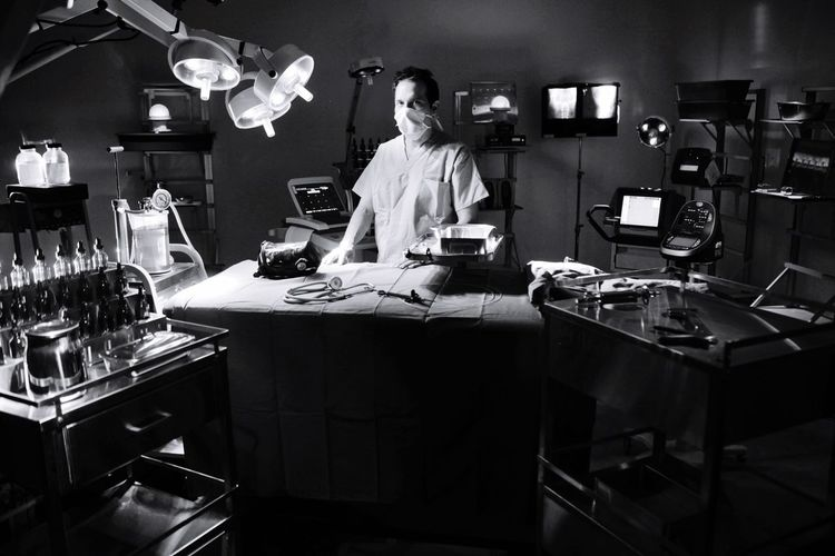 Portrait Of Doctor Standing In Operating Room