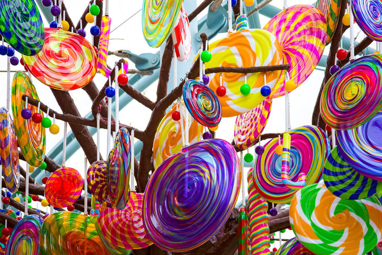 Low angle view of multi colored decorations for sale in market