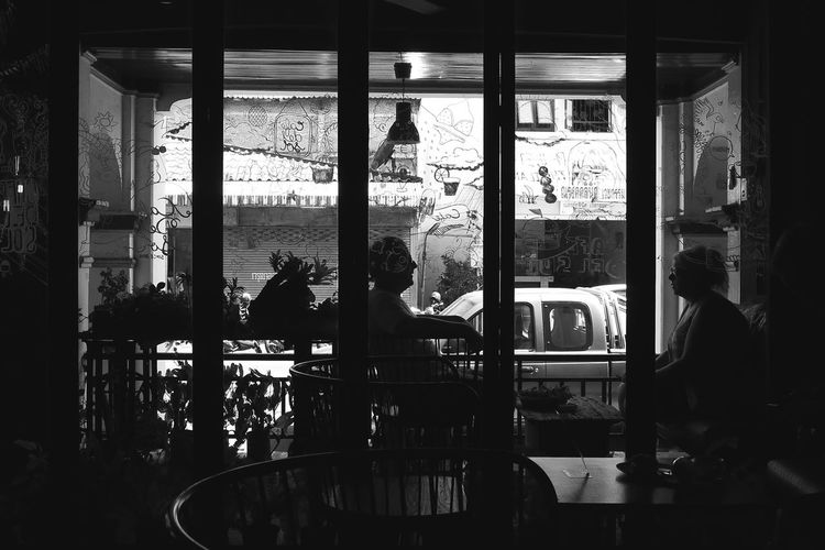 Silhouette people sitting in restaurant