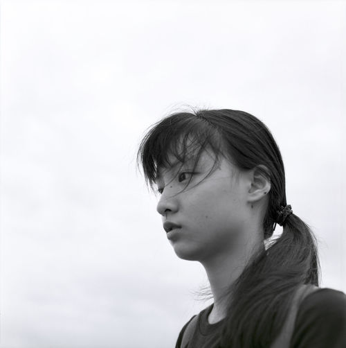 Close-Up Of Girl Against Clear Sky