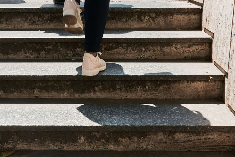 Low Section Real People Body Part Human Leg Human Body Part One Person Staircase Day Architecture Lifestyles Steps And Staircases Sunlight Nature Standing Leisure Activity Outdoors Women Water Shadow Human Foot Human Limb