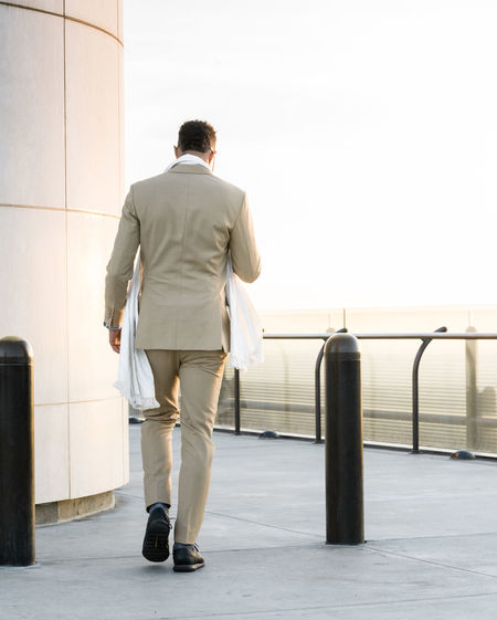 Rear view of a man walking rooftop