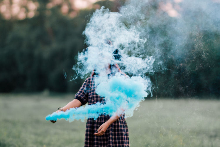Woman holding smoke bomb