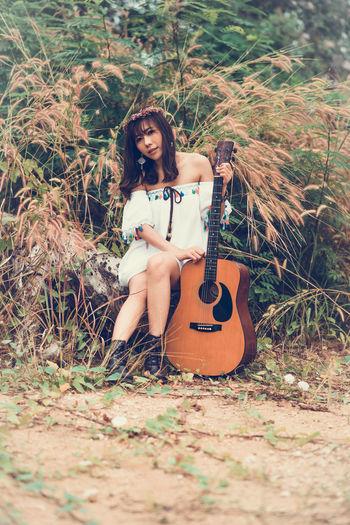 Woman sitting guitar