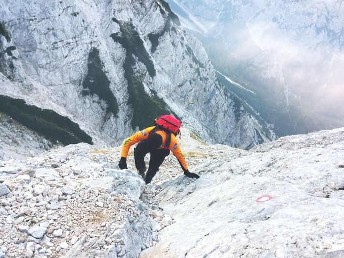 High angle view of person climbing on rocky mountain