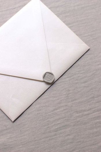 High angle view of white paper on table