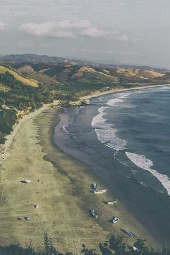 View of a semi-virgin beach on the coast of the state of Michoacan. Beach Beauty In Nature Day Landscape Mountain Nature No People Outdoors Scenics Sky Tranquil Scene Tranquility Virgin Beach Water An Eye For Travel