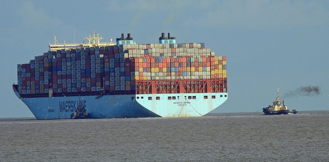Container Ships Harwich, Essex North Sea Coast Shipping Containers Black Smoke Duel Funnels Export Industry Freight Transportation Fully Laden Large Ship Nautical Vessels Sea Tugs A New Beginning