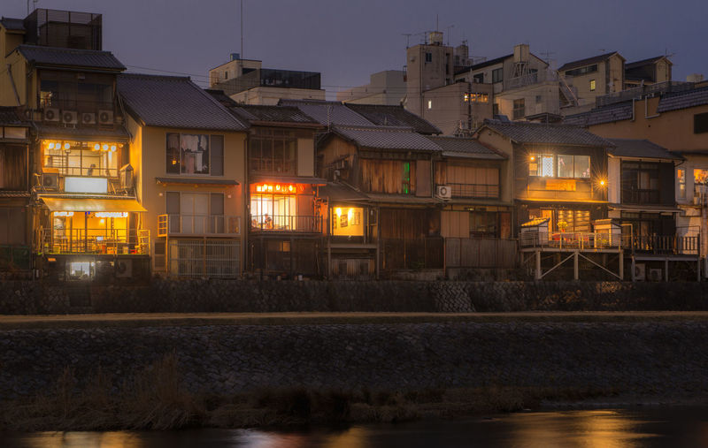 Old house and restaurant at Kamo river, Kyoto, Japan Architecture Building Exterior Built Structure Illuminated Water Building City Nature No People Waterfront Night Residential District River Sky Dusk Reflection House Outdoors Town