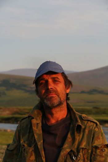 Portrait of man standing against outdoors during sunset