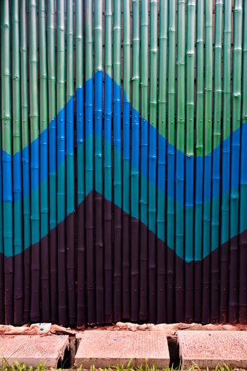 Metal gate against blue wall