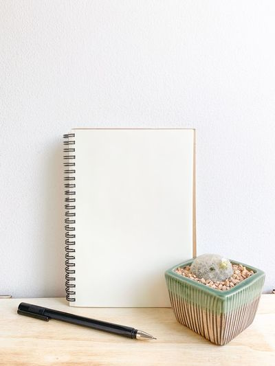 Close-up of book on table against white background