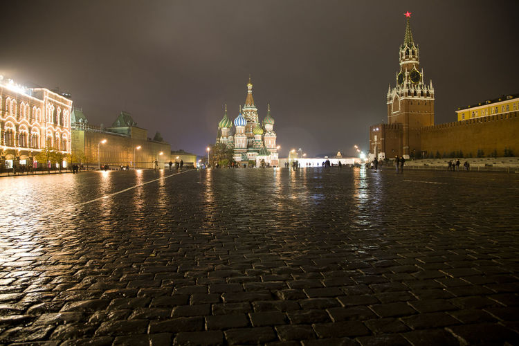 Illuminated St Basil Cathedral In Front Of Walkway At Night