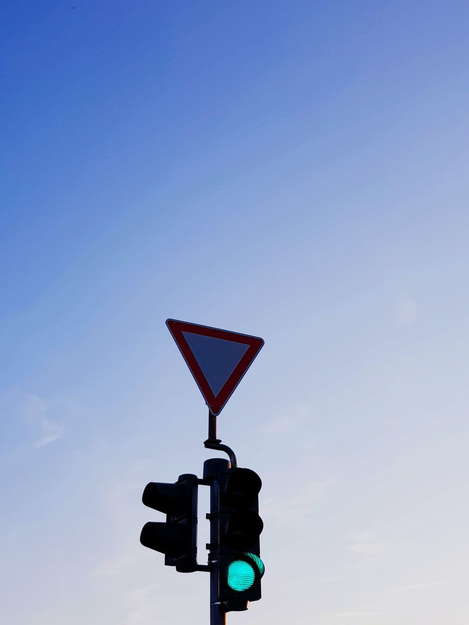 low angle view, guidance, sky, copy space, red light, outdoors, no people, railway signal, red, day, blue, stoplight, road sign