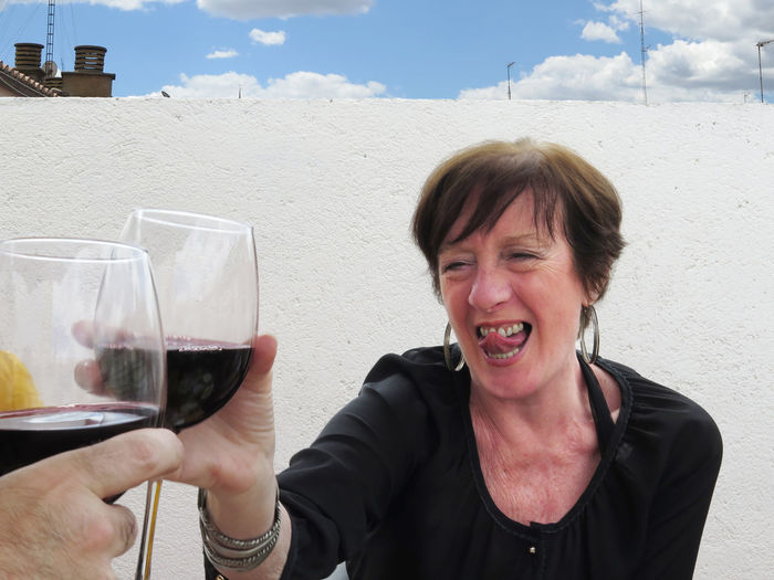 Smiling woman toasting wineglass
