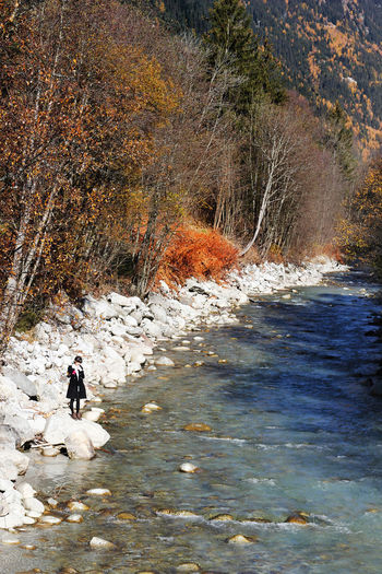 Man walking by river