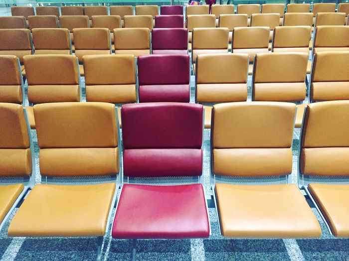 Full frame shot of empty chairs at airport