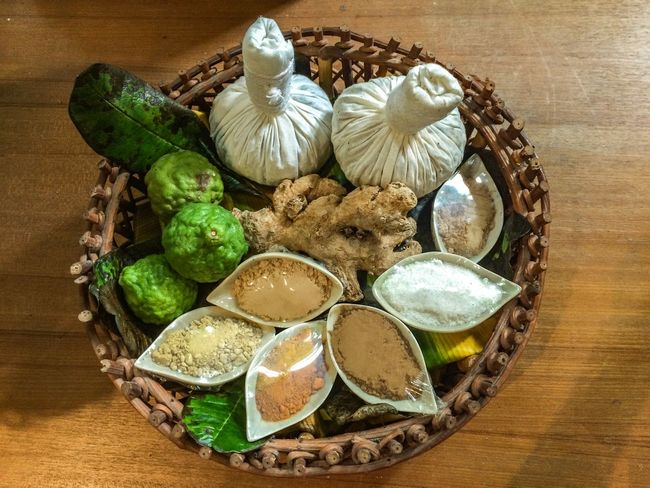 Herbal Compress Bergamot Bergamot Leaf Ginger Herbal Compress High Angle View Still Life Table Food Indoors  No People Food And Drink Freshness Basket Healthy Eating Close-up Wellbeing Ready-to-eat Decoration Wood - Material Vegetable Container Temptation Green Color Fruit