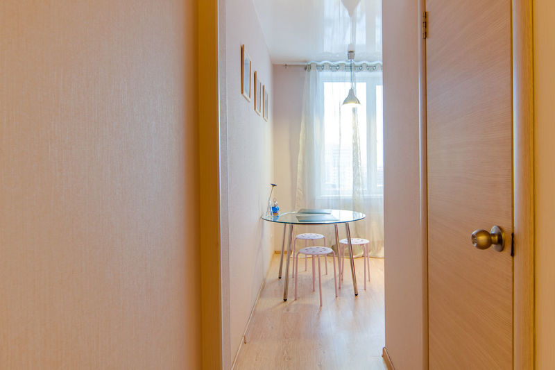 Indoors  Absence Door Entrance Window Home Interior Architecture Seat No People Wood - Material Day Domestic Room Chair Furniture Building Table Flooring Empty Home Built Structure