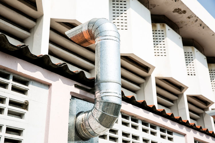 Low angle view of pipes on roof of building