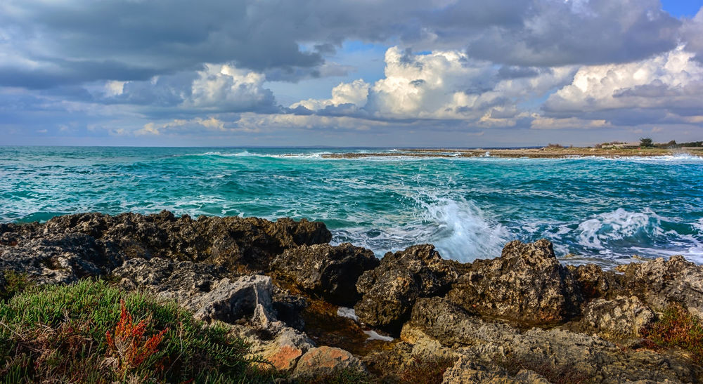 Beach Beauty In Nature Cloud - Sky Horizon Horizon Over Water Idyllic Land Nature No People Outdoors Power In Nature Rock Rock - Object Scenics - Nature Sea Sky Solid Tranquil Scene Tranquility Turquoise Colored Water Wave