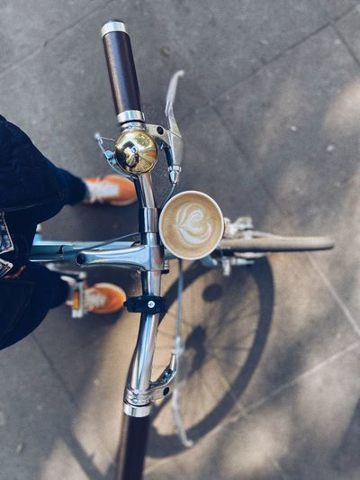 High angle view of person riding bicycle on street