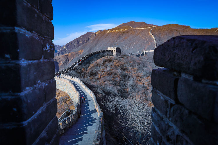 View of great wall against blue sky