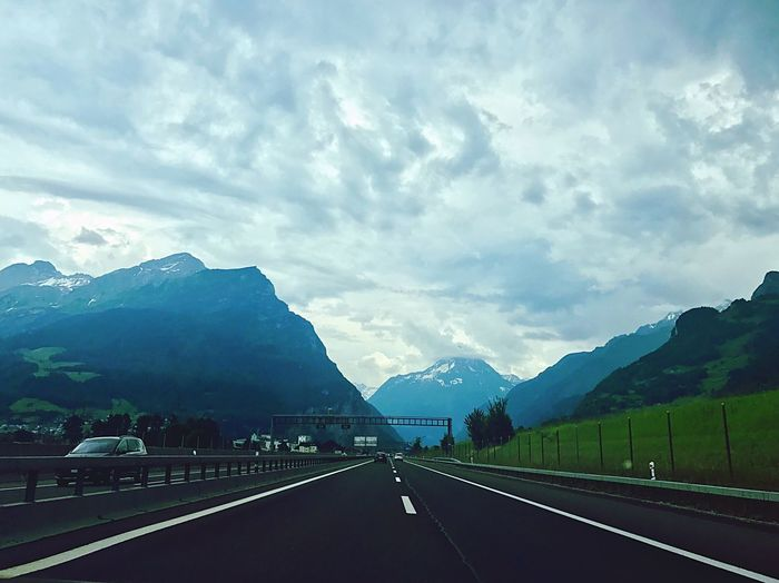 Mountain Road Transportation The Way Forward Sky Beauty In Nature Cloud - Sky Nature Day Mountain Range Outdoors Tranquility Scenics No People Travel Switzerland