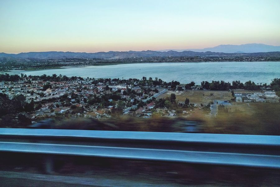 evening view of the lake Outdoors Wide Shot Lake View Lake Views EyeEm Gallery In A Car Mountain Range Going Home Late Evening On The Road Clear Sky Beauty In Nature Twilight Mobile Photography TakeoverContrast Sunset Non-urban Scene