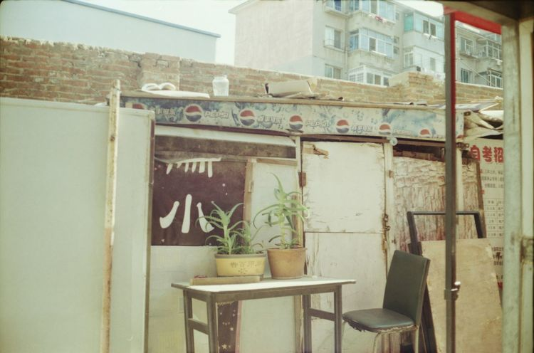 Analogue Photography Architecture Backstreets & Alleyways Building Exterior Built Structure China Day Flowers No People Outdoors Plants Trash Window