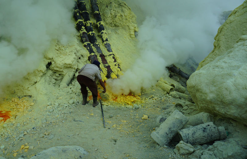 The miner at ijen crater indonesia