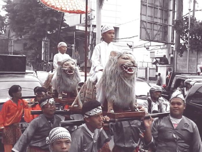 Indonesian culture Sisingaan Taking Photos