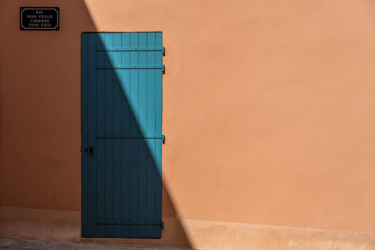 "my entry in the ""minimalist"" type of photo. so, what do you think? Sonya6500 A6500 Zeiss Zeiss1670 Doorshadow Shadowoverdoor Travel Travel Photography Frenchriviera Riviera Shadow Composition Bluedoor Shadow Door Architecture Building Exterior Built Structure Entryway Closed Door Front Door Entrance Wall Entry"