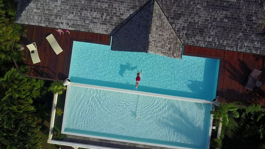 Lost In The Landscape Swimming Pool High Angle View Tourism Travel Destinations French Polynesia Moorea One Person Jumping Into Water